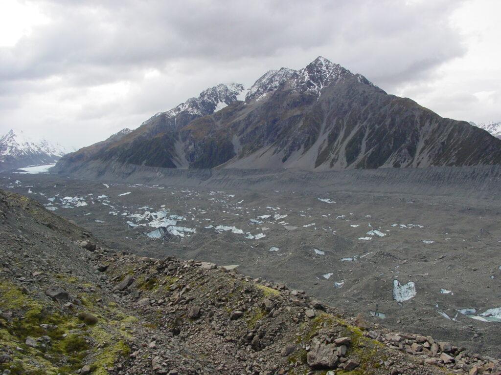 The lower Tasman Glacier, white ice in the far left distance