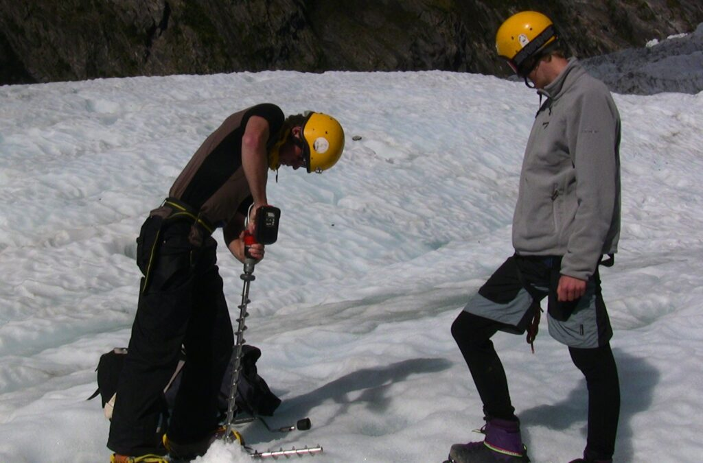 Drilling holes for ablation stakes on Fox Glacier