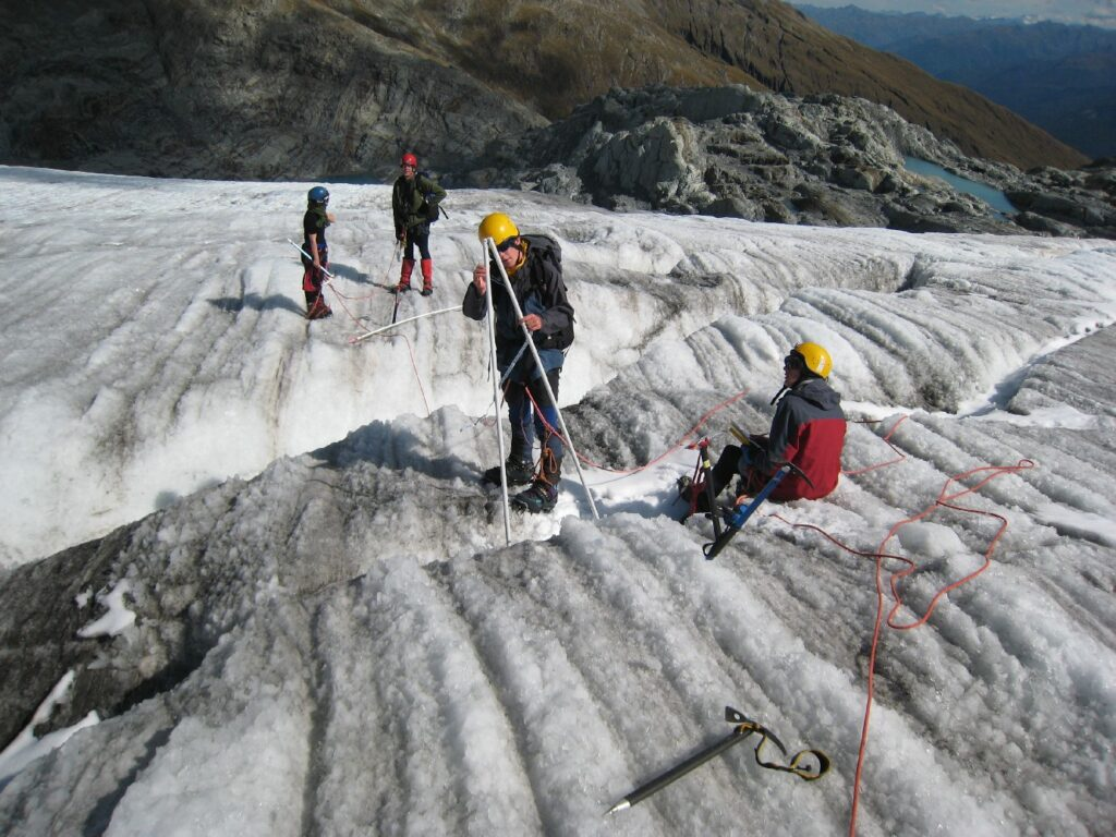 Measuring ablation stakes on the Brewster Glacier